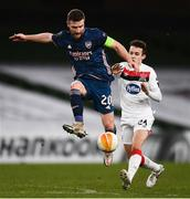 10 December 2020; Shkodran Mustafi of Arsenal and Jamie Wynne of Dundalk during the UEFA Europa League Group B match between Dundalk and Arsenal at the Aviva Stadium in Dublin. Photo by Ben McShane/Sportsfile