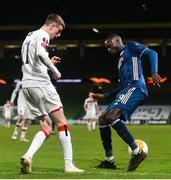 10 December 2020; Nicolas Pépé of Arsenal and Daniel Kelly of Dundalk during the UEFA Europa League Group B match between Dundalk and Arsenal at the Aviva Stadium in Dublin. Photo by Ben McShane/Sportsfile