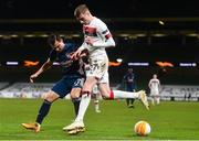 10 December 2020; Daniel Kelly of Dundalk and Cédric of Arsenal during the UEFA Europa League Group B match between Dundalk and Arsenal at the Aviva Stadium in Dublin. Photo by Ben McShane/Sportsfile
