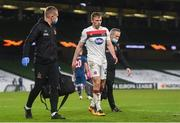 10 December 2020; David McMillan of Dundalk leaves the pitch with an injury during the UEFA Europa League Group B match between Dundalk and Arsenal at the Aviva Stadium in Dublin. Photo by Ben McShane/Sportsfile