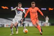 10 December 2020; Rúnar Rúnarsson of Arsenal and Daniel Kelly of Dundalk during the UEFA Europa League Group B match between Dundalk and Arsenal at the Aviva Stadium in Dublin. Photo by Ben McShane/Sportsfile