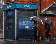 13 December 2020; Locals walk past the closed Croke Park ticket office during a rain downpour prior to the GAA Hurling All-Ireland Senior Championship Final match between Limerick and Waterford at Croke Park in Dublin. Photo by Piaras Ó Mídheach/Sportsfile