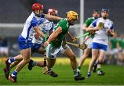 13 December 2020; Tom Morrissey of Limerick breaks clear from Darragh Lyons and Calum Lyons of Waterford during the GAA Hurling All-Ireland Senior Championship Final match between Limerick and Waterford at Croke Park in Dublin. Photo by Ray McManus/Sportsfile