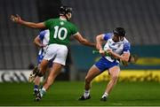 13 December 2020; Iarlaith Daly of Waterford is tackled by Gearóid Hegarty of Limerick during the GAA Hurling All-Ireland Senior Championship Final match between Limerick and Waterford at Croke Park in Dublin. Photo by Ray McManus/Sportsfile
