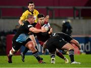 13 December 2020; Conor Murray of Munster is tackled by Wilco Louw, left, and Joe Marler of Harlequins during the Heineken Champions Cup Pool B Round 1 match between Munster and Harlequins at Thomond Park in Limerick. Photo by Seb Daly/Sportsfile