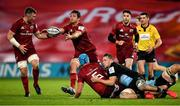 13 December 2020; Tadhg Beirne of Munster off-loads to team-mates Peter O'Mahony, left, and Jean Kleyn as he is tackled by Alex Dombrandt of Harlequins during the Heineken Champions Cup Pool B Round 1 match between Munster and Harlequins at Thomond Park in Limerick. Photo by Seb Daly/Sportsfile