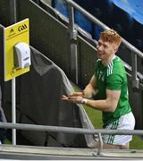 13 December 2020; Cian Lynch of Limerick sanitises his hand before lifting the Liam MacCarthy cup after the GAA Hurling All-Ireland Senior Championship Final match between Limerick and Waterford at Croke Park in Dublin. Photo by Daire Brennan/Sportsfile
