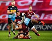 13 December 2020; Tadhg Beirne of Munster is tackled by Marcus Smith and Nathan Earle of Harlequins during the Heineken Champions Cup Pool B Round 1 match between Munster and Harlequins at Thomond Park in Limerick. Photo by Seb Daly/Sportsfile