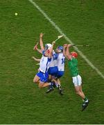 13 December 2020; Waterford players, left to right, Calum Lyons, Stephen Bennett, and Austin Gleeson in action against Barry Nash of Limerick during the GAA Hurling All-Ireland Senior Championship Final match between Limerick and Waterford at Croke Park in Dublin. Photo by Daire Brennan/Sportsfile