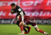 13 December 2020; Nathan Earle of Harlequins is tackled by Conor Murray of Munster during the Heineken Champions Cup Pool B Round 1 match between Munster and Harlequins at Thomond Park in Limerick. Photo by Seb Daly/Sportsfile
