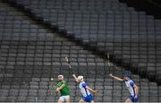 13 December 2020; Aaron Gillane of Limerick shoots for a score despite the efforts of Shane McNulty and Conor Prunty of Waterford, right, in front of an empty Hogan Stand during the GAA Hurling All-Ireland Senior Championship Final match between Limerick and Waterford at Croke Park in Dublin. Photo by Brendan Moran/Sportsfile