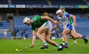 13 December 2020; Kyle Hayes of Limerick lifts the sliotar as he races clear of Neil Montgomery of Waterford during the GAA Hurling All-Ireland Senior Championship Final match between Limerick and Waterford at Croke Park in Dublin. Photo by Brendan Moran/Sportsfile