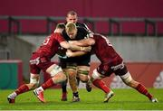 13 December 2020; Hugh Tizard of Harlequins is tackled by Jack O'Donoghue, left, and Gavin Coombes during the Heineken Champions Cup Pool B Round 1 match between Munster and Harlequins at Thomond Park in Limerick. Photo by Seb Daly/Sportsfile