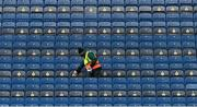 13 December 2020; Steward Tom Ryan wipes the seats prior to the GAA Hurling All-Ireland Senior Championship Final match between Limerick and Waterford at Croke Park in Dublin. Photo by Piaras Ó Mídheach/Sportsfile