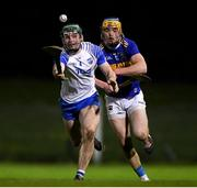 15 December 2020; Sam Fitzgerald of Waterford in action against Conor Bowe of Tipperary during the Bord Gáis Energy Munster GAA Hurling U20 Championship Semi-Final match between Waterford and Tipperary at Fraher Field in Dungarvan, Waterford. Photo by Matt Browne/Sportsfile