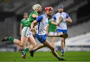 13 December 2020; Calum Lyons of Waterford in action against Cian Lynch of Limerick during the GAA Hurling All-Ireland Senior Championship Final match between Limerick and Waterford at Croke Park in Dublin. Photo by Ramsey Cardy/Sportsfile