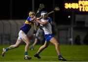 15 December 2020; Paddy Leevy of Waterford in action against Conor Bowe of Tipperary during the Bord Gáis Energy Munster GAA Hurling U20 Championship Semi-Final match between Waterford and Tipperary at Fraher Field in Dungarvan, Waterford. Photo by Matt Browne/Sportsfile