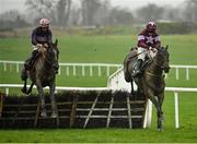18 December 2020; Percy Warner, left, with Jack Kennedy up, jumps the last alongside eventual second place Flanking Maneuver, with Sean Flanagan up, on their way to winning the Irish Stallion Owners EBF Maiden Hurdle at Navan Racecourse in Meath. Photo by Seb Daly/Sportsfile