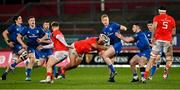 18 December 2020; Jamie Osborne of Leinster is tackled by Roman Salanoa of Munster during the A Interprovincial Friendly match between Munster A and Leinster A at Thomond Park in Limerick. Photo by Brendan Moran/Sportsfile