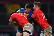 18 December 2020; Rowan Osborne of Leinster is tackled by Chris Cloete, left, and Jack Crowley of Munster during the A Interprovincial Friendly match between Munster A and Leinster A at Thomond Park in Limerick. Photo by Brendan Moran/Sportsfile