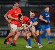 18 December 2020; Jake Flannery of Munster is tackled by David Hawkshaw of Leinster during the A Interprovincial Friendly match between Munster A and Leinster A at Thomond Park in Limerick. Photo by Brendan Moran/Sportsfile