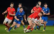18 December 2020; Jake Flannery of Munster collects a loose ball ahead of David Hawkshaw of Leinster during the A Interprovincial Friendly match between Munster A and Leinster A at Thomond Park in Limerick. Photo by Brendan Moran/Sportsfile