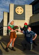 19 December 2020; Mayo supporters Sophie Van Aalst from Wassenaar, Netherlands, and Shane Fitzgerald, from Kilmaine, Mayo, pose for a photograph with Dublin supporter Dermot McGuckin, from Kimmage prior to to the GAA Football All-Ireland Senior Championship Final match between Dublin and Mayo at Croke Park in Dublin. Photo by Seb Daly/Sportsfile