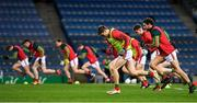 19 December 2020; Lee Keegan, centre, and Tom Parsons warm-up with their Mayo team-mates ahead of the GAA Football All-Ireland Senior Championship Final match between Dublin and Mayo at Croke Park in Dublin. Photo by Seb Daly/Sportsfile
