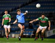 19 December 2020; Seán Bugler of Dublin, under pressure from Chris Barrett of Mayo, kicks his side's third point, in the 11th minute, during the GAA Football All-Ireland Senior Championship Final match between Dublin and Mayo at Croke Park in Dublin. Photo by Ray McManus/Sportsfile