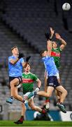 19 December 2020; Oisín Mullin of Mayo contests a high ball against Paul Mannion, left, and Con O'Callaghan of Dublin during the GAA Football All-Ireland Senior Championship Final match between Dublin and Mayo at Croke Park in Dublin. Photo by Seb Daly/Sportsfile