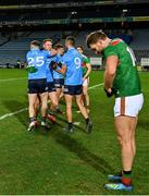 19 December 2020; Dublin players, from left, Philip McMahon, Brian Fenton and James McCarthy celebrates in front of Mayo's Aidan O'Shea following their side's victory during the GAA Football All-Ireland Senior Championship Final match between Dublin and Mayo at Croke Park in Dublin. Photo by Seb Daly/Sportsfile