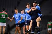 19 December 2020; Dublin players Michael Fitzsimons, left, and David Byrne, right, celebrate with Michael Darragh MacAuley following the GAA Football All-Ireland Senior Championship Final match between Dublin and Mayo at Croke Park in Dublin. Photo by Sam Barnes/Sportsfile