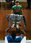 19 December 2020; Diarmuid O'Connor of Mayo leaves the pitch as Brian Howard of Dublin lifts the Sam Maguire Cup after the GAA Football All-Ireland Senior Championship Final match between Dublin and Mayo at Croke Park in Dublin. Photo by Brendan Moran/Sportsfile