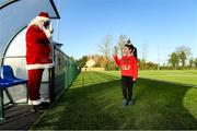 20 December 2020; Santa Claus with Avene Doyle at Tullow RFC during Leinster Tullow RFC Minis Training at Tullow RFC in Tullow, Carlow. Photo by Matt Browne/Sportsfile