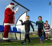20 December 2020; Harry Byrne and Ava Deagan with Santa Claus during the Leinster Tullow RFC Minis Training at Tullow RFC in Tullow, Carlow. Photo by Matt Browne/Sportsfile