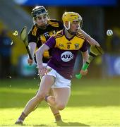 20 December 2020; Oisín Pepper of Wexford in action against Harry Shine of Kilkenny during the Electric Ireland Leinster GAA Hurling Minor Championship Semi-Final match between Wexford and Kilkenny at Chadwicks Wexford Park in Wexford. Photo by Seb Daly/Sportsfile