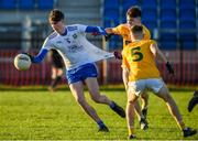 20 December 2020; Tiarnan O'Rourke of Monaghan in action against Eunan Quinn of Antrim during the Electric Ireland Ulster Minor Football Championship Quarter Final match between Antrim and Monaghan at Corrigan Park in Belfast. Photo by Philip Fitzpatrick/Sportsfile