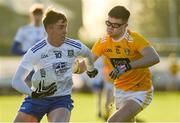 20 December 2020; Ryan Duffy of Monaghan in action against Calum Higgins of Antrim during the Electric Ireland Ulster Minor Football Championship Quarter Final match between Antrim and Monaghan at Corrigan Park in Belfast. Photo by Philip Fitzpatrick/Sportsfile