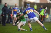 20 December 2020; Eoin Harmon of Limerick in action against Kenny Lee of Tipperary during the Electric Ireland Munster GAA Hurling Minor Championship Final match between Limerick and Tipperary at LIT Gaelic Grounds in Limerick. Photo by David Fitzgerald/Sportsfile
