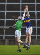 20 December 2020; Shane O'Brien of Limerick in action against Joe Caesar of Tipperary during the Electric Ireland Munster GAA Hurling Minor Championship Final match between Limerick and Tipperary at LIT Gaelic Grounds in Limerick. Photo by David Fitzgerald/Sportsfile