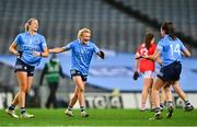 20 December 2020; Carla Rowe of Dublin, centre, celebrates with team-mates Jennifer Dunne, left, Niamh McEvoy following the TG4 All-Ireland Senior Ladies Football Championship Final match between Cork and Dublin at Croke Park in Dublin. Photo by Eóin Noonan/Sportsfile