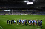 20 December 2020; The Dublin team stand for a moment's silence after placing a wreath at the Bloody SUnday memorial on Hill 16 after the TG4 All-Ireland Senior Ladies Football Championship Final match between Cork and Dublin at Croke Park in Dublin. Photo by Brendan Moran/Sportsfile