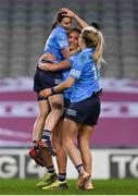 20 December 2020; Dublin captain Sinéad Aherne, left, celebrates with team-mates Niamh McEvoy and Nicole Owens after the TG4 All-Ireland Senior Ladies Football Championship Final match between Cork and Dublin at Croke Park in Dublin. Photo by Brendan Moran/Sportsfile