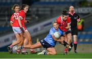 20 December 2020; Hannah Looney of Cork is tackled by Jennifer Dunne of Dublin during the TG4 All-Ireland Senior Ladies Football Championship Final match between Cork and Dublin at Croke Park in Dublin. Photo by Brendan Moran/Sportsfile