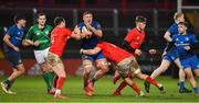 18 December 2020; Scott Penny of Leinster is tackled by Seán French, left, and Alex Kendellen of Munster during the A Interprovincial Friendly match between Munster A and Leinster A at Thomond Park in Limerick. Photo by Brendan Moran/Sportsfile