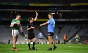 19 December 2020; Jonny Cooper of Dublin is shown a yellow card by referee David Coldrick during the GAA Football All-Ireland Senior Championship Final match between Dublin and Mayo at Croke Park in Dublin. Photo by Sam Barnes/Sportsfile