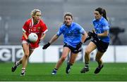 20 December 2020; Orla Finn of Cork in action against Aoife Kane, left, and Lyndsey Davey of Dublin during the TG4 All-Ireland Senior Ladies Football Championship Final match between Cork and Dublin at Croke Park in Dublin. Photo by Piaras Ó Mídheach/Sportsfile