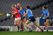 20 December 2020; Saoirse Noonan of Cork in action against Dublin players, from left, Sinéad Goldrick, Siobhán McGrath and Martha Byrne during the TG4 All-Ireland Senior Ladies Football Championship Final match between Cork and Dublin at Croke Park in Dublin. Photo by Piaras Ó Mídheach/Sportsfile