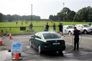 15 August 2020; Dean Adams from Scrub A Dub car wash washing a car during the Dublin County Senior 1 Football Championship Group 2 Round 3 match between Na Fianna and Ballinteer St Johns at Balgriffin in Dublin. Photo by David Fitzgerald/Sportsfile