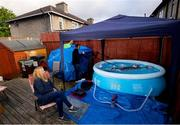 29 April 2020; Swimmer Mia Whelan-O'Connor of ESB Swimming Club swims in her back garden in an inflatable pool, in Inchicore, Dublin, using a swimming parachute and a bungee cord with the assistance of her Dad Michael and Mother Carol. Following directives from the Irish Government, the majority of sporting associations have suspended all organised sporting activity in an effort to contain the spread of the Coronavirus (COVID-19) pandemic. Photo by Ramsey Cardy/Sportsfile